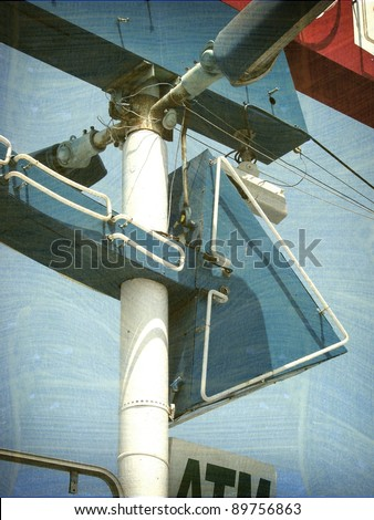 aged and worn vintage photo of neon arrow sign - stock photo