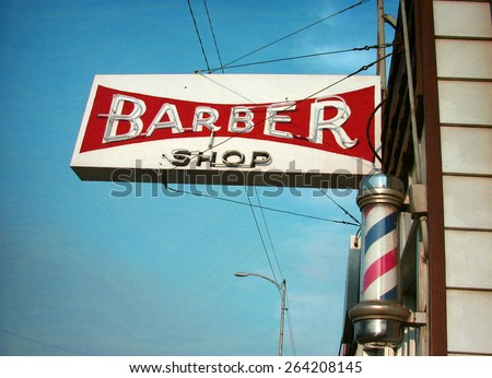aged and worn vintage photo of neon barber shop sign - stock photo