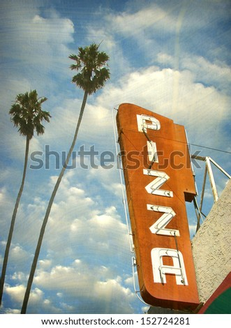 aged and worn vintage photo of neon sign and palm trees                                - stock photo