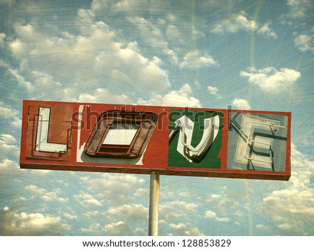 aged and worn vintage photo of neon sign with message - stock photo