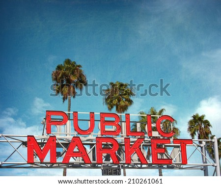aged and worn vintage photo of neon sign with palm trees - stock photo
