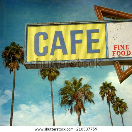 aged and worn vintage photo of old cafe sign on  beach                               - stock photo