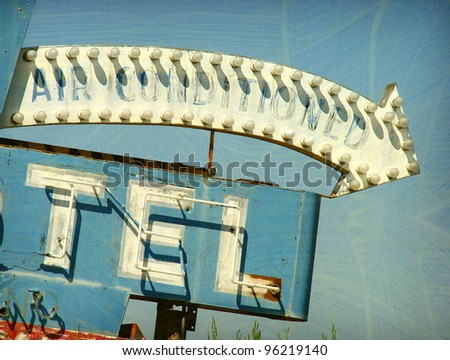 aged and worn vintage photo of old neon sign - stock photo