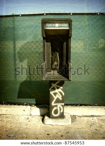 aged and worn vintage photo of old public phone booth - stock photo