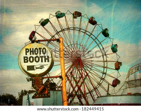 aged and worn vintage photo of photo booth sign with ferris wheel                              - stock photo