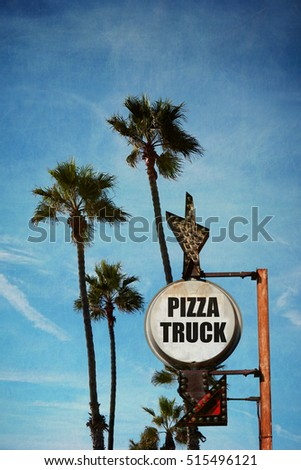 aged and worn vintage photo of pizza truck sign with palm trees