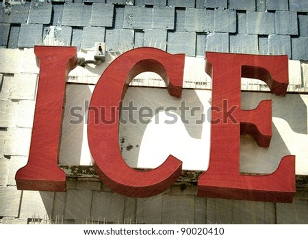 aged and worn vintage photo of red ice sign