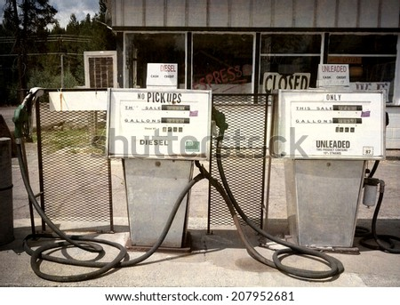 aged and worn vintage photo of retro gas pumps - stock photo