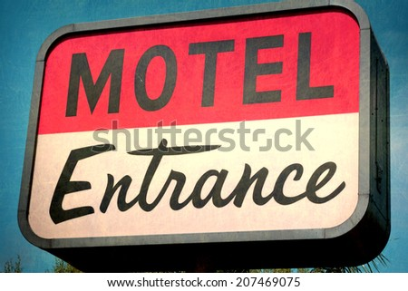 aged and worn vintage photo of retro sign                                - stock photo
