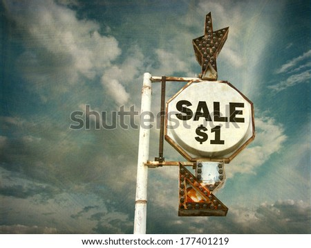aged and worn vintage photo of sale sign with arrow                                - stock photo
