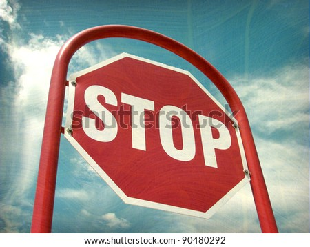 aged and worn vintage photo of stop sign - stock photo