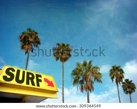 aged and worn vintage photo of surf sign with palm trees                               - stock photo