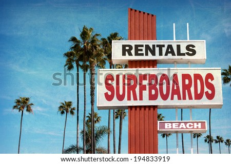 aged and worn vintage photo of surfboard rentals sign - stock photo