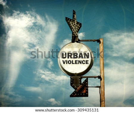 aged and worn vintage photo of urban violence sign - stock photo