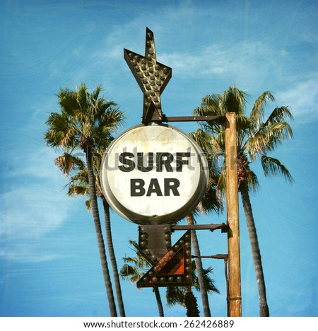 aged and worn vintage surf bar sign with palm trees - stock photo