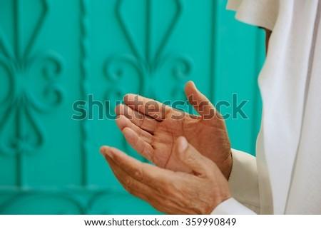 Aged Arabic man praying - stock photo