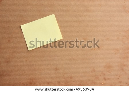 Aged background with blank post it note