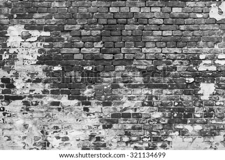 Aged black and white brick wall background with peeled white paint.  - stock photo