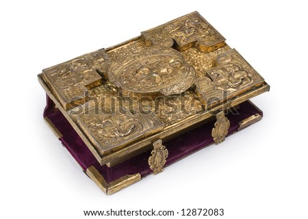 Aged book in metal framework at white background