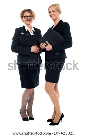 Aged businesswomen posing with documents,full length shot