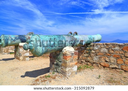 Aged canons on a deck above the sea inside Saint Tropez fortress, French Riviera, France - stock photo