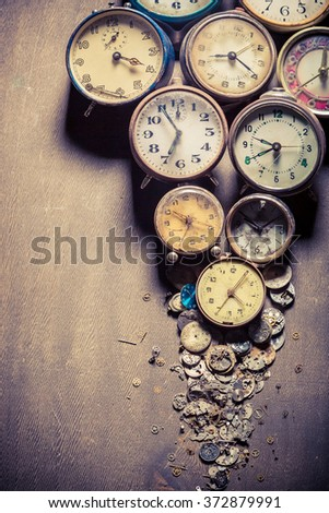 Aged clocks in pile
