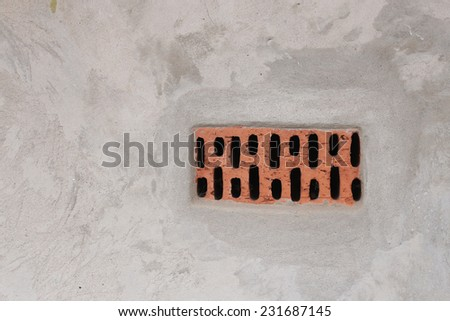 Aged concrete background with red brick - stock photo