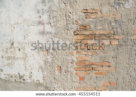 Aged crack cement orange brick wall