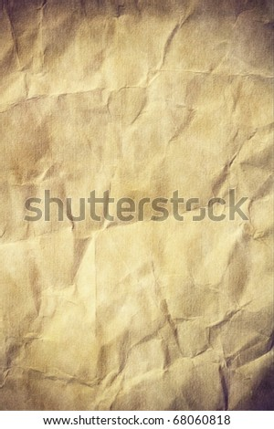 Aged crumpled paper with space for text or image - stock photo