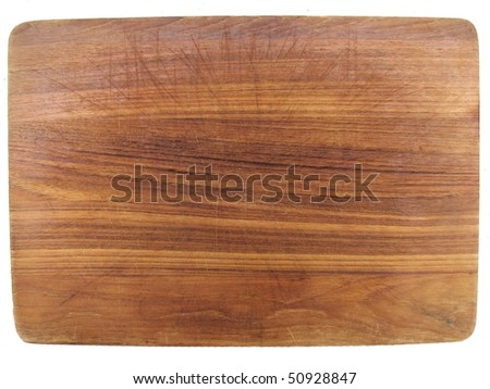 aged dark chopping board out of wood with cuts - stock photo