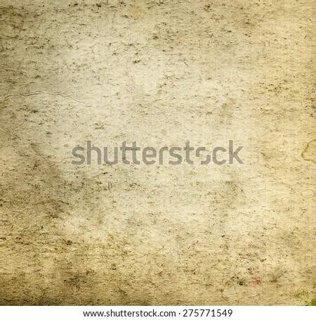 Aged dirty beige brown paper canvas grunge background or texture. Closeup - stock photo
