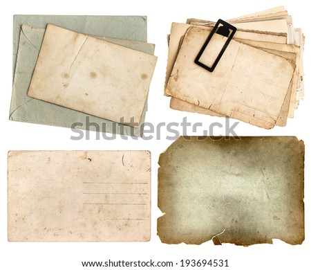 aged grungy papers and postcards isolated on white background - stock photo
