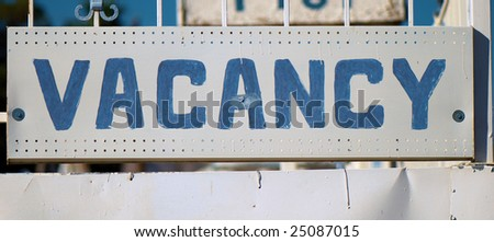 Aged hand-painted Vacancy sign - stock photo