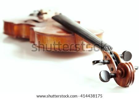 aged handmade violin on white background - stock photo