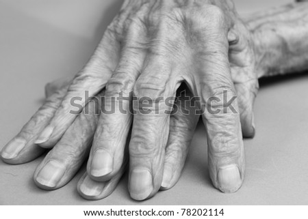 aged hands of a woman who is ninety years of age - stock photo