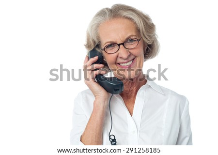 Aged happy woman answering a phone call - stock photo