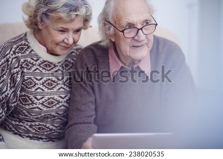Aged husband and wife in sweaters - stock photo