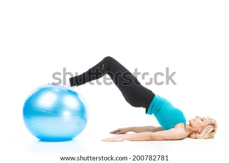 aged lady workout on white background. blond woman with legs on fitness ball - stock photo