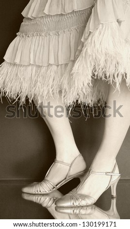 Aged-looking and textured photo of an interesting feathered dress. Intentional texture and grain. - stock photo