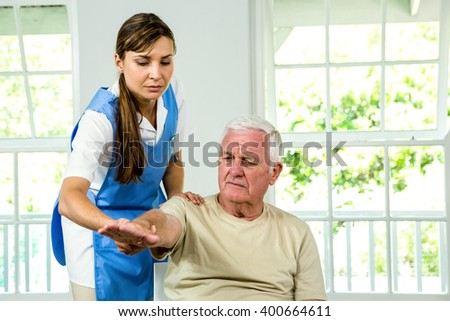 Aged man being examined by nurse at health club