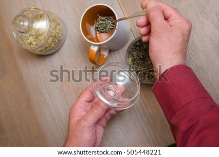 Aged man making tea on the kitchen