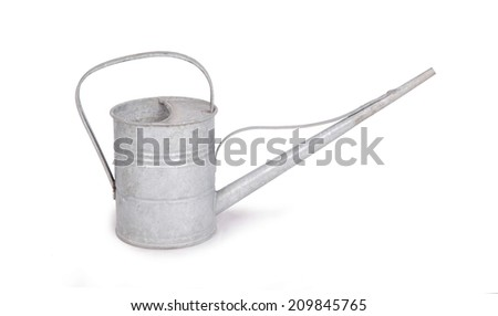 Aged metallic watering can isolated on white background