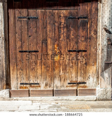 Aged old doors in Venice, Italy - stock photo