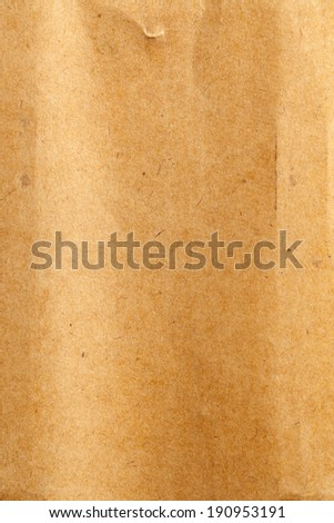 Aged old grungy brown paper background texture - stock photo