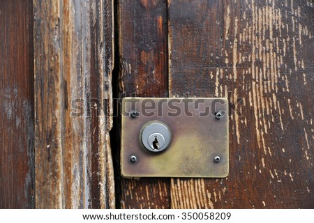Aged old key hole on old wooden door