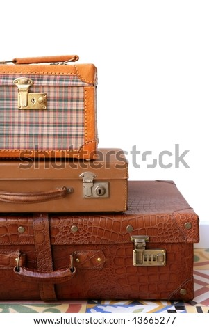 Aged old luggage leather bags vintage retro stacked baggage cases - stock photo