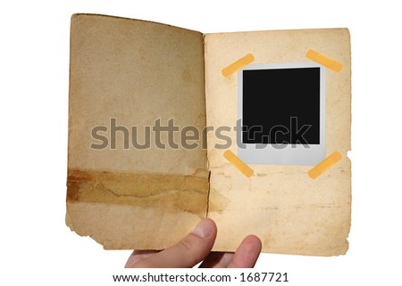 aged open book  with instant photo frame