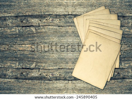 aged paper sheets over rustic wooden background. grunge vintage texture - stock photo