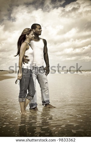 Aged photo of couple on a beach