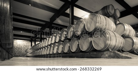 Aged photo of many  barrels in wine cellar - stock photo